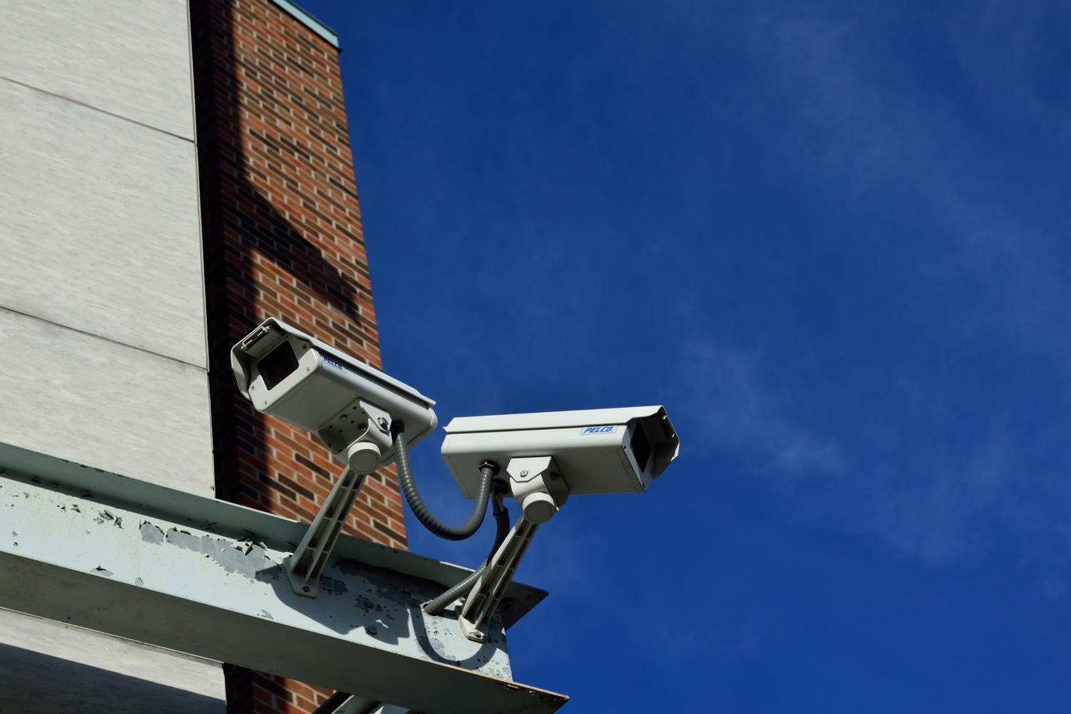 Security camera operating as part of a physical security information management system