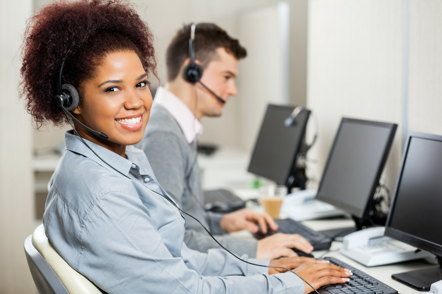 Happy call center agent responding to the voice of the customer
